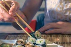 在街道咖啡馆的寿司 库存照片