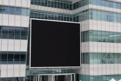 在街道墙壁上的大空白的广告牌 库存图片