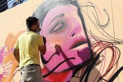 在街道艺术节Thess期间的画家街道画 库存照片