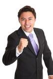 在衣服和领带的年轻商人 图库摄影