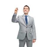在衣服文字的愉快的商人某事 免版税库存照片