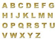 在衣服饰物之小金属片信件的原始的英语字母表颜色金子 库存图片