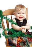 在补缀品礼服的可爱的圣诞节婴孩岩石 免版税库存照片