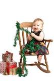 在补缀品礼服的笑的圣诞节婴孩岩石 免版税库存图片