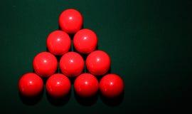 在表上的红色落袋撞球球 免版税库存图片