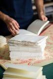 在表上的被堆积的纸在工厂 免版税库存图片
