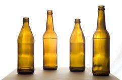 在表的四个啤酒瓶 库存图片