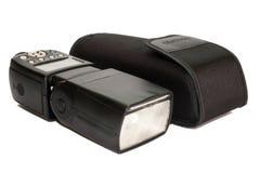 在袋子的照相机闪光 免版税库存图片