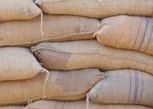 在袋子的米从仓库 免版税库存照片