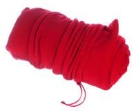 在袋子的滚动的红色毯子 免版税库存图片