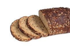 在被切的种子上添面包 免版税库存照片