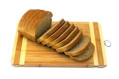 在被切的褐色上添面包 库存照片