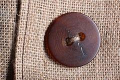 在被回收的黑森州的大袋的礼服按钮 免版税库存照片
