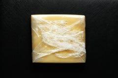 在被密封的塑料的乳酪 图库摄影