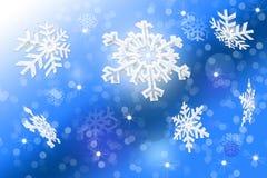 在被弄脏的蓝色背景的白色雪花 库存照片