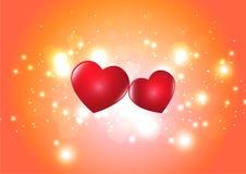 在被弄脏的闪烁的橙色bokeh背景的两红心 库存照片