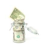 在被打开的瓶子的美元钞票 库存图片