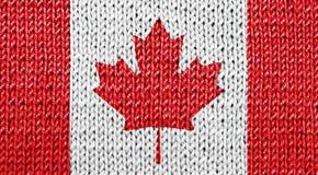 在被编织的背景的加拿大国旗 图库摄影