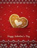 在被编织的背景的心脏曲奇饼 免版税库存图片