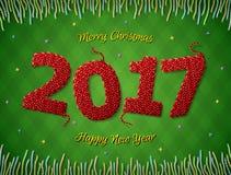在被编织的织品形状的新年2017年在方格的背景的 免版税库存图片