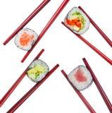 在被隔绝的木红色筷子的寿司集合 图库摄影