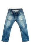 在被隔绝的白色的老牛仔裤 免版税库存照片