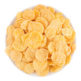在被隔绝的白色碗,顶视图的金黄玉米片 谷物 免版税库存照片
