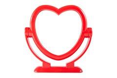 在被隔绝的红色心脏框架的镜子 免版税库存照片