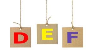 在被隔绝的纸板标签的字母表信件 2件装饰品设置了 图库摄影