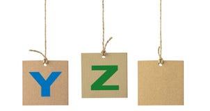 在被隔绝的纸板标签的字母表信件 集合9 图库摄影