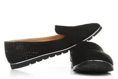 在被隔绝的背景的鞋子 图库摄影