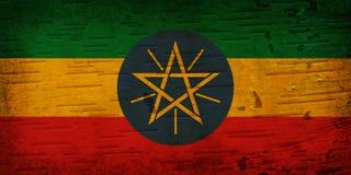 在被风化的木头的一面土气老埃塞俄比亚旗子 库存例证