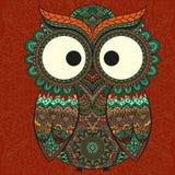 在被仿造的背景的装饰猫头鹰 免版税库存图片