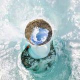 在裂缝里面的女性在冰冰川冰岛 一点行星球状360 180全景  免版税图库摄影