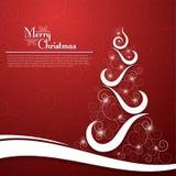 在装饰红色背景的圣诞树 图库摄影