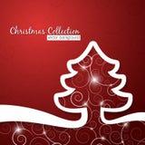 在装饰红色背景的圣诞树 库存照片