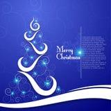 在装饰蓝色背景的圣诞树 免版税库存图片