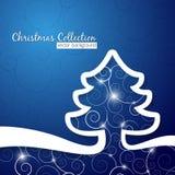 在装饰蓝色背景的圣诞树 库存照片