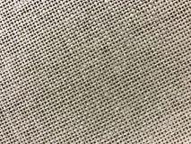在褐色的镶边亚麻制大袋纹理背景 免版税库存照片