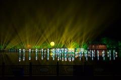 在西湖激光的印象-在附近瓷-与激光和被带领的光的夜 库存图片
