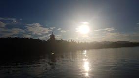 在西湖的日落 免版税库存图片