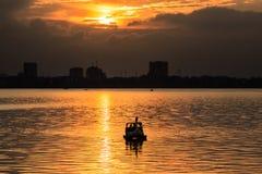 在西湖的日落 免版税图库摄影