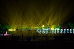 在西湖莲花的印象扇动-在附近瓷-与激光和被带领的光的夜 库存图片