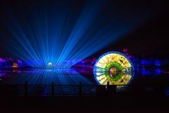 在西湖莲花的印象扇动-在附近瓷-与激光和被带领的光的夜 图库摄影