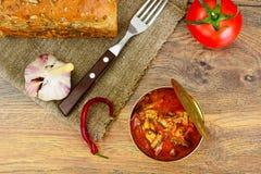 在西红柿酱的罐装鱼西鲱 库存照片
