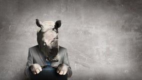 在西装穿戴的犀牛 混合画法 库存照片