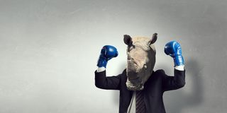 在西装穿戴的犀牛 混合画法 库存图片
