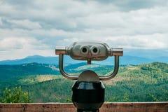 在观察平台的双筒望远镜 免版税图库摄影