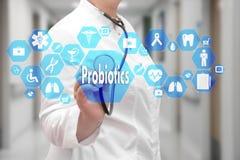 在触摸屏上的Probiotics有在医学backgr的象的 免版税图库摄影