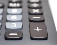 在计算器隔离的正按钮在白色 免版税库存图片